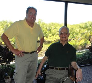 This photo shows charles schwab architect with is friend wALLY dUTCHER SHOWN HERE USING A WHEELCHAIR